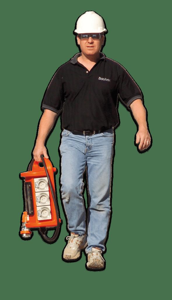 Shane Soltoggio owner of Bosbox carrying a power board