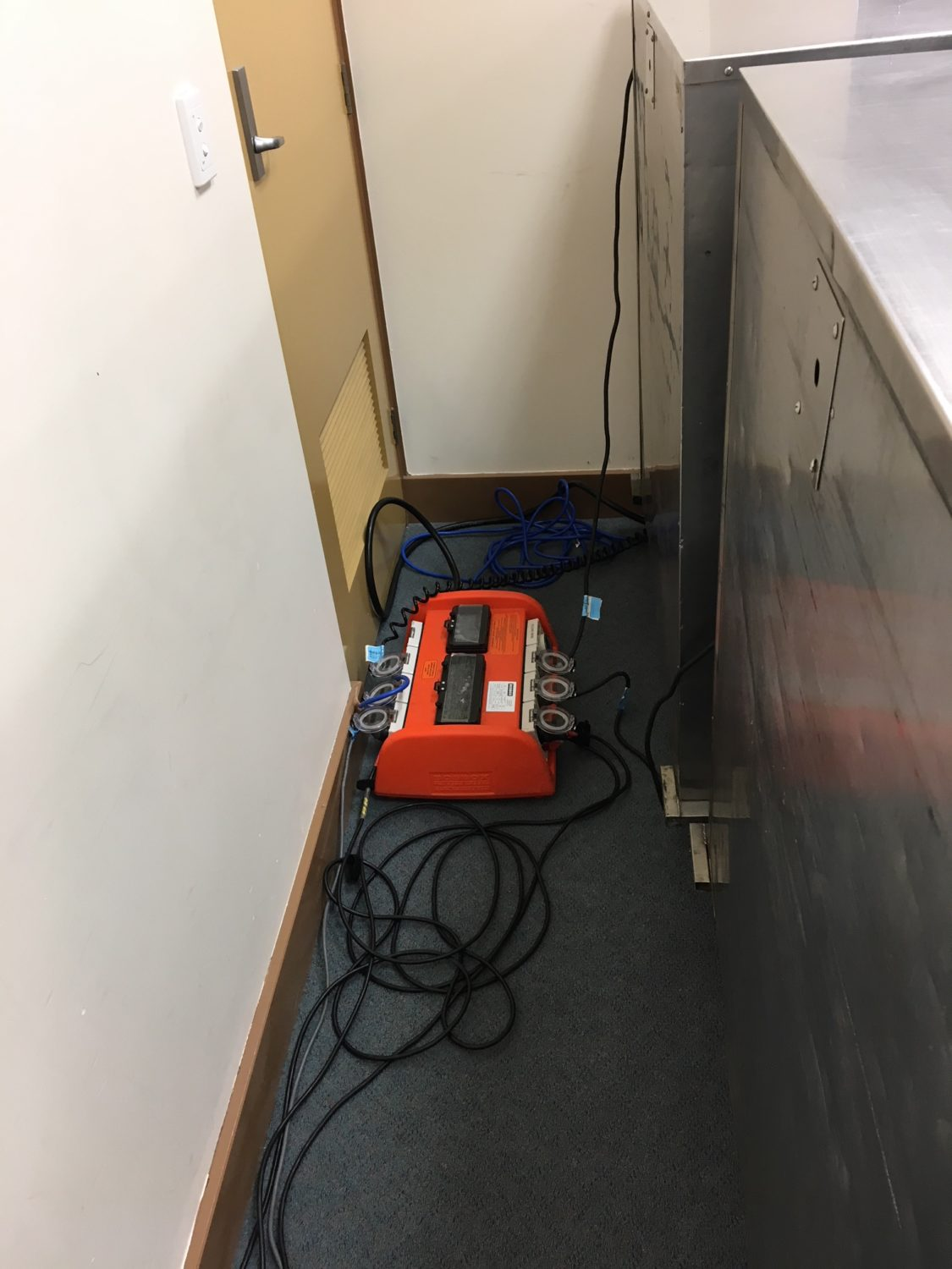 Mini power board tucked behind some cabinets